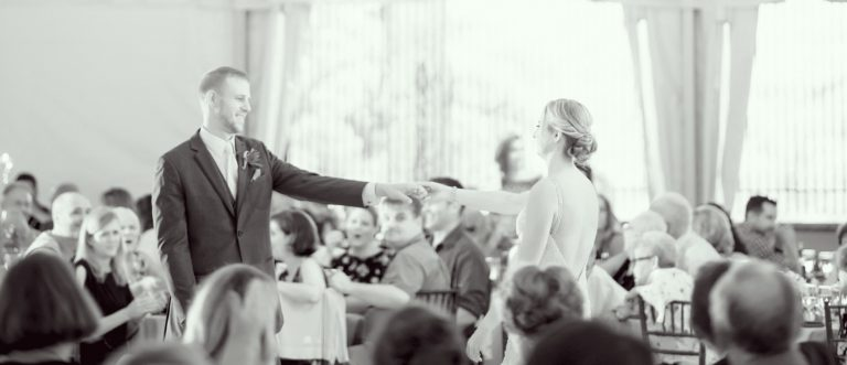 Wedding couple dancing their first dance in black and white.